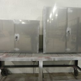 STAINLESS STEEL ENCLOSURES WITH LOCKING HANDLES