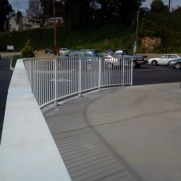 FABRICATION AND INSTALLATION OF STEEL HANDRAIL WITH RADIUS PAINTED BLACK