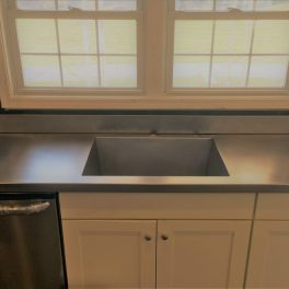 STAINLESS STEEL COUNTERTOP INSTALLATION WITH WELDED SINK